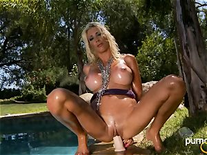 Puma Swede site her muff on her intimate fake penis outdoor