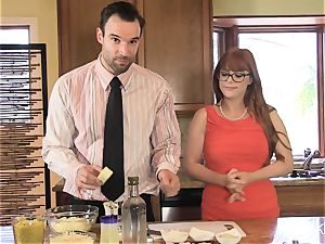 Penny Pax plows in the kitchen