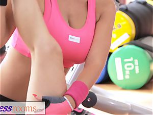 FitnessRooms private trainer with hefty bra-stuffers